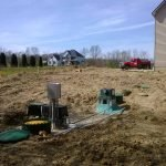 Septic system installation at new home contruction site